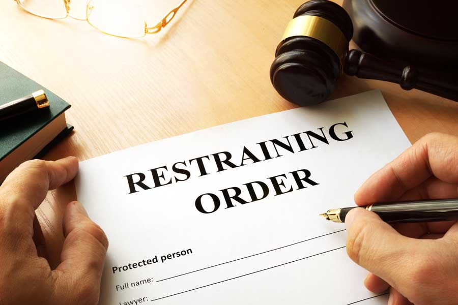 Restraining order form being filled by a Chicago criminal lawyer